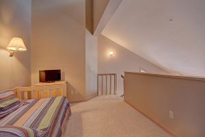 Loft Area (Bedroom #3) with Twin and Twin Trundle, En-suite Bath and TV