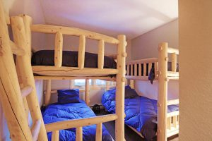 Log Bunk Room with 3 Twins and a Full Bed