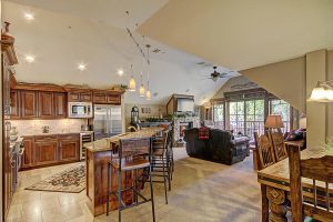 Living, Dining, Kitchen View with High End Rustic Furnishings