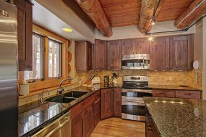 Fully Updated and Stocked Kitchen with Warm Alder Cabinetry