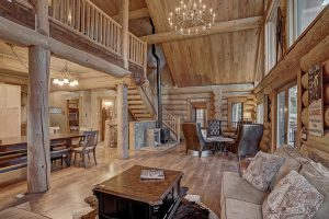 Great Room Area with Beautiful Exposed Logs and Woodwork