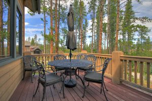 Main Floor Deck with Patio Furniture and Gas Grill