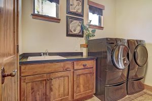 Laundry Room with Front-Load Washer & Dryer and Utility Sink