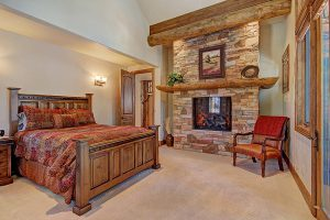 Master Bedroom with Queen Bed and Cozy Gas Fireplace