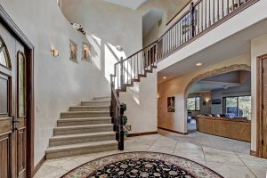 Foyer with Curved Staircase and Vaulted Ceiling