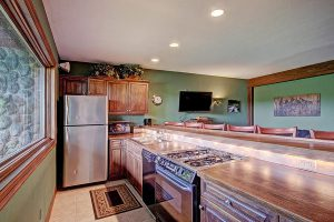 Lower Level Kitchen with Gas Range, Microwave, & Refrigerator