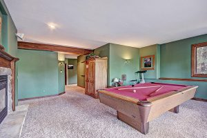 Lower Level Game Room with Pool Table and Gas Fireplace