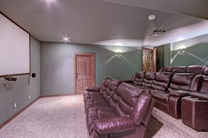 Lower Level Theater Room with 10 ft. Screen & Surround Sound
