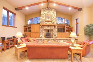 Vaulted Ceilings and Beautiful Stone Fireplace Surround