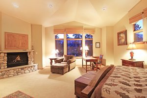 Master Bedroom Blazing Gas Fireplace and TV