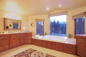 Master Bath with His and Her Vanities and a Double Soaking Tub