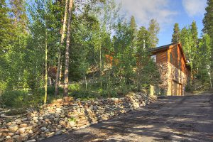 View of Driveway and Forested Property Surrounding Homestead Retreat