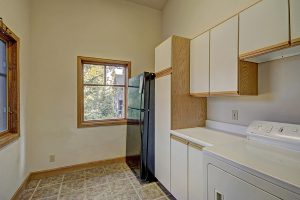 Laundry Room with an Additional Refrigerator